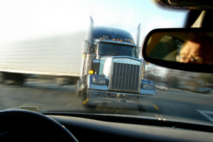 Car About to Crash into Semi-Truck